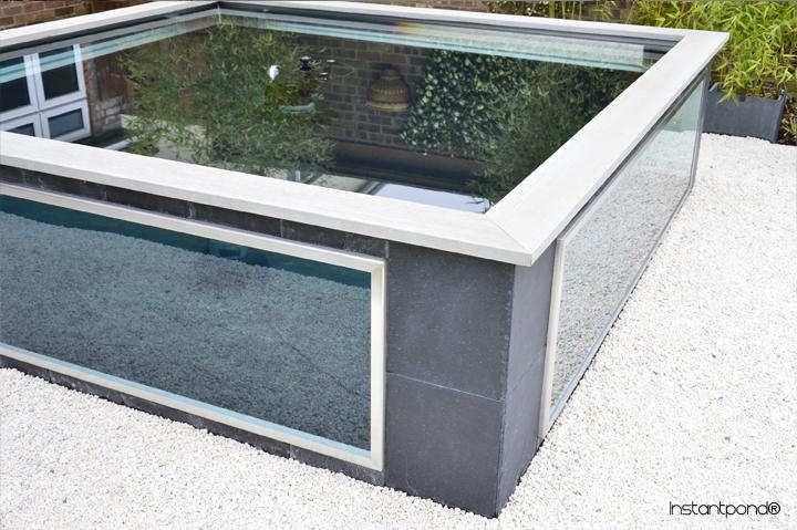 Comment ajouter une vitre sur son bassin for Premade koi ponds